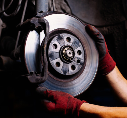 Technician holding automotive brake